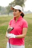 Golfspelare med en klubba Royaltyfri Bild