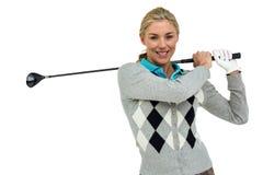 Golfspelare som tar ett skott Royaltyfri Bild
