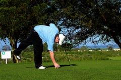 Golfspeler stock afbeelding
