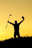 Golfspeler bij zonsondergang Stock Fotografie