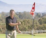 Golfspeler die rond wint Royalty-vrije Stock Fotografie