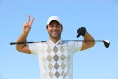 Golfspeler die vredesteken geeft Stock Afbeeldingen