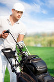 Golfspeler met golfmateriaal Royalty-vrije Stock Foto's