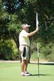 Golfspeler op Green Stock Afbeelding