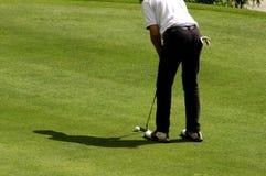 Golfspeler op green Royalty-vrije Stock Foto