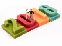 Golfspelertribune op aantal van Gelukkig nieuw jaar 2018 Stock Foto's