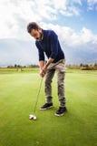 golfspelet fotografering för bildbyråer