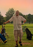 Golfspelet i sun-duschar Royaltyfri Foto