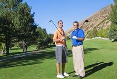 Golfspieler auf dem Golfplatz Stockbilder