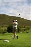 Golfspieler auf dem Stückkasten Lizenzfreie Stockfotografie