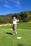Golfspieler auf dem Stückkasten. Stockbild