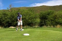 Golfspieler auf dem Stückkasten. Stockfotos
