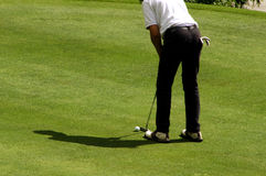Golfspieler auf einem Grün Lizenzfreies Stockfoto