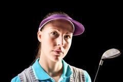 Golfspieler auf schwarzem Hintergrund Stockfotos