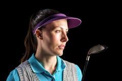 Golfspieler auf schwarzem Hintergrund Stockfoto