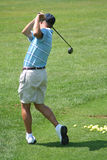 Golfspieler-übendes Laufwerk Stockbilder