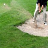 Golfspieler in der Tätigkeit Lizenzfreie Stockbilder