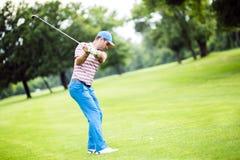 Golfspieler, der Vorher-Nachher-Foto übt und konzentriert Lizenzfreies Stockfoto