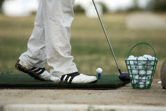 Golfspielerbohrung schoss zuerst stockbild