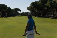 Golfspielerporträt von der Rückseite Lizenzfreie Stockfotos