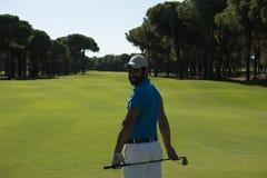 Golfspielerporträt von der Rückseite Stockfotografie