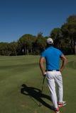 Golfspielerporträt von der Rückseite Stockbilder