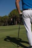 Golfspielerporträt von der Rückseite Stockbild