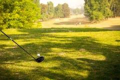 Golfstick och boll Royaltyfria Foton