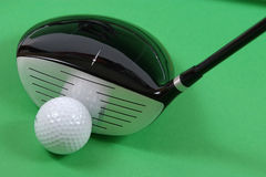 Golg clubs. Golf clubs on green background Royalty Free Stock Photography