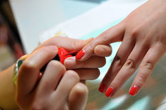 Golg nails. Painting on nails of bride Stock Image