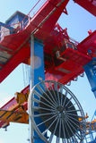 Goliath crane. Red and blue Goliath crane loading of goods on blue sky background Stock Photos