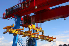 Goliath crane. Red, yellow and blue Goliath crane loading of goods on clear blue sky background Royalty Free Stock Photography