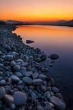 Golpe violento del río de la puesta del sol Imagenes de archivo