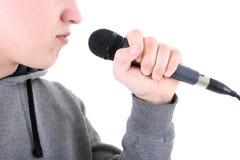 Golpeador con el micrófono Fotografía de archivo libre de regalías