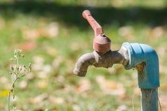 Golpecito de agua oxidado Fotografía de archivo