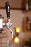 Golpecito de la cerveza Foto de archivo libre de regalías