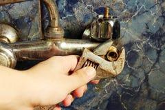 Golpecito del fontanero Imagenes de archivo