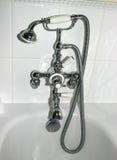 Golpecitos de la ducha del cuarto de baño Foto de archivo