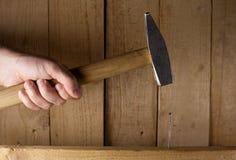 Golpee el clavo en la pista Imagen de archivo libre de regalías
