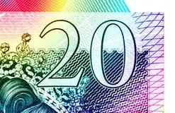 Golpee el fondo de la moneda - 20 libras - arco iris Fotos de archivo libres de regalías