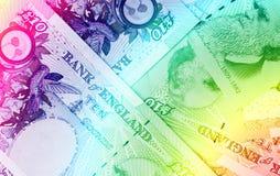 Golpee el fondo de la moneda - 10 libras - arco iris Imágenes de archivo libres de regalías