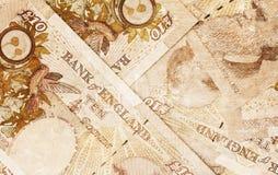Golpee el fondo de la moneda - 10 libras - sepia del vintage Fotografía de archivo libre de regalías