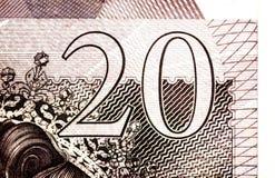 Golpee el fondo de la moneda - 20 libras - sepia del vintage Imagen de archivo