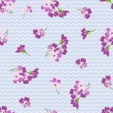 Golpeteo floral inconsútil con las pequeñas flores rosadas Imagenes de archivo
