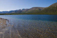Goltsovoe lake. A mountain lake with limpid water reflecting the hills behind it Royalty Free Stock Photos