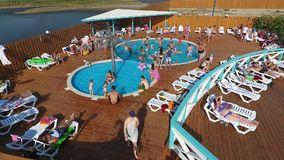 Oasis Basin in the village of Golubitskaya, Krasnodar Territory. People are relaxing in the pool. Swimming pool for adults and chi stock footage