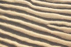 Golven in het zand Royalty-vrije Stock Afbeeldingen