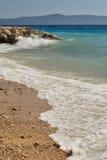 Golven op het strand Stock Afbeelding