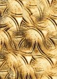 Golvend defocused naadloze 3d gouden achtergrond stock foto