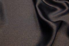 Golvende de textuurachtergrond van de stoffenclose-up Stock Foto